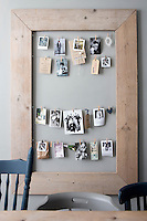 A salvaged homemade wood frame is an imaginative way to display photos and postcards