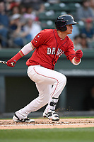 Catcher Samuel Miranda (21) of the Greenville Drive bats in a game against the Rome Braves on Saturday, April 14, 2018, at Fluor Field at the West End in Greenville, South Carolina. Rome won, 4-0. (Tom Priddy/Four Seam Images)