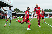 Billy Clifford of Crawley Town (18) (center) clears the ball  during the Sky Bet League 2 match between Crawley Town and Luton Town at the Broadfield/Checkatrade.com Stadium, Crawley, England on 17 September 2016. Photo by Edward Thomas / PRiME Media Images.