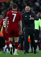 30th October 2019; Anfield, Liverpool, Merseyside, England; English Football League Cup, Carabao Cup, Liverpool versus Arsenal; Liverpool assistant coach Pepijn Lijnders celebrates his team's penalty shootout win with captain James Milner  - Strictly Editorial Use Only. No use with unauthorized audio, video, data, fixture lists, club/league logos or 'live' services. Online in-match use limited to 120 images, no video emulation. No use in betting, games or single club/league/player publications