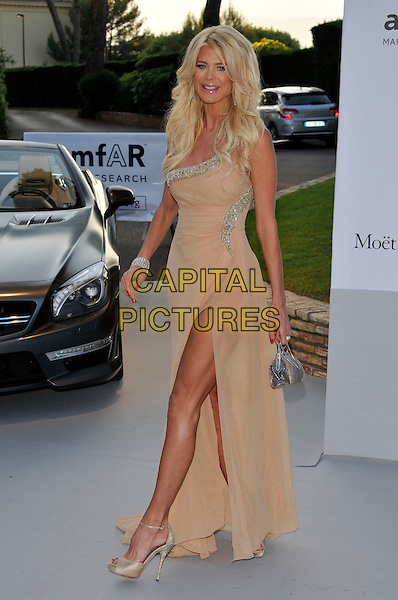 Victoria Silvstedt.AmFAR Cinema Against AIDS 2012, Hotel du Cap, Antibes during the 65th  Cannes Film Festival, France..24th May 2012.full length dress silver beige slit split side  beads beaded clutch bag.CAP/PL.©Phil Loftus/Capital Pictures.
