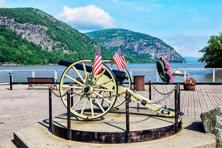 The Cold Spring riverfront in summer. The cannon in the center is a replica of a Parrott Gun, a type of rifled cannon that was manufactured at the West Point Foundry in Cold Spring during the Civil War and was a major factor in many Union victories. The mountain in the center background is Storm King Mountain.