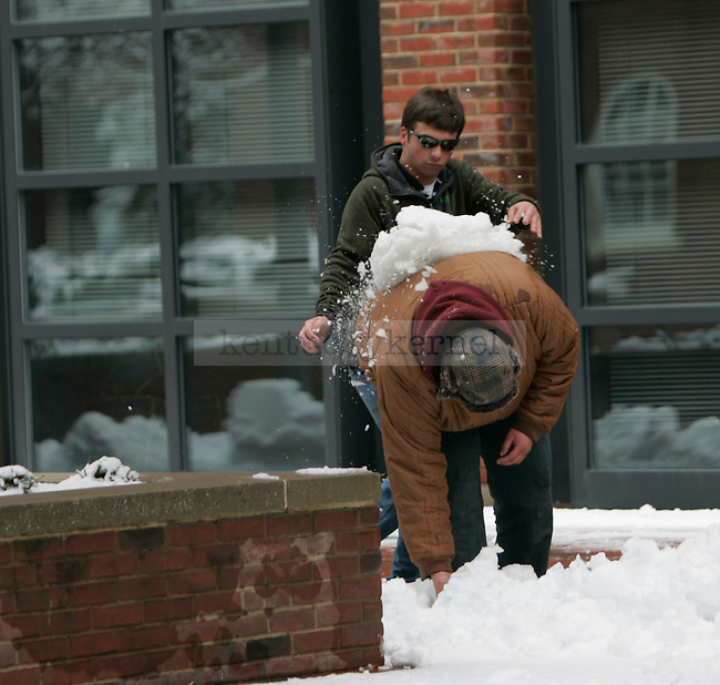 Computer science junior Max Burnham dumps a block of snow on mechanical engineering junior Ricky Gantt during a snowball fight outside the engineering annex at the University of Kentucky in Lexington, Ky., on Monday, Mar. 5, 2012. Photo by Tessa Lighty | Staff
