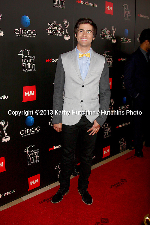 LOS ANGELES - JUN 16:  Max Ehrich arrives at the 40th Daytime Emmy Awards at the Skirball Cultural Center on June 16, 2013 in Los Angeles, CA