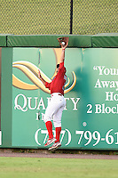 Clearwater Threshers outfielder Nick Ferdinand (21) catches a fly ball at the wall during a game against the Tampa Yankees on June 26, 2014 at Bright House Field in Clearwater, Florida.  Clearwater defeated Tampa 4-3.  (Mike Janes/Four Seam Images)