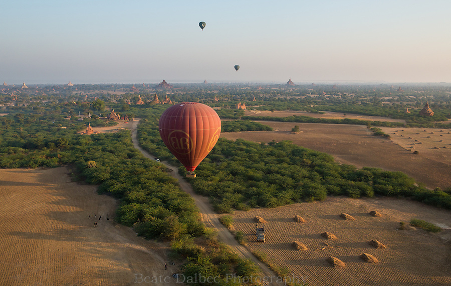 hot air balloon coming in for a landing in Bagan, Myanmar