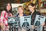 "BOOK: Reading over Padraig kennelly's book ""Eyewitness"" on Saturday in O'Mahony's Bookstore were l-r:Mairead Hurley, Mags O'Donnell and Ciara Hurley.."