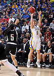 SIOUX FALLS, SD - MARCH 7:  Madison Guebert #11 of South Dakota State shoots a 3-pointer against defender Amber Vidal #5 of Omaha in the 2016 Summit League Tournament. (Photo by Dave Eggen/Inertia)