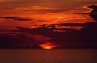 Rick Wilson Photo--6/8/04--The sun starts to rise above the horizon over the Atlantic Ocean as seen from Jacksonville Beach, Florida Tuesday morning June 8, 2004.