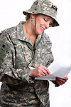 A happy USA military woman soldier reading a letter from home