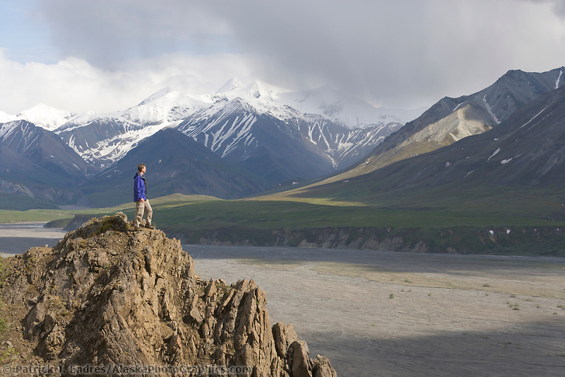 Hiker walks a rocky ridge along the Thorofare river, Denali National Park, Alaska