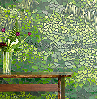 Living Wall, a waterjet mosaic, shown in shades of green Serenity glass, is part of the Broad Street&trade; collection.<br />