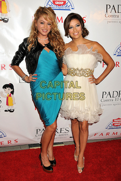 PAULINA RUBIO & EVA LONGORIA PARKER.9th Annual Padres Contra El Cancer Benefit Gala held at the Hollywood Palladium, Hollywood, California, USA..September 10th, 2009.full length strapless white cream ruffles ruffled hem tulle dress gold waistband hands on hips shoes draped peep toe platform turquoise blue black jacket leather.CAP/ADM/BP.©Byron Purvis/AdMedia/Capital Pictures.