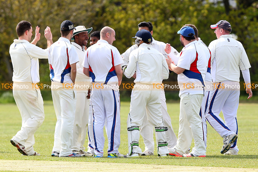 Hornchurch Athletic players celerate the first Rayleigh wicket - Rayleigh Fairview CC (batting) vs Hornchurch Athletic CC - Mid-Essex Essex Cricket League - 02/05/15 - MANDATORY CREDIT: Gavin Ellis/TGSPHOTO - Self billing applies where appropriate - 0845 094 6026 - contact@tgsphoto.co.uk - NO UNPAID USE