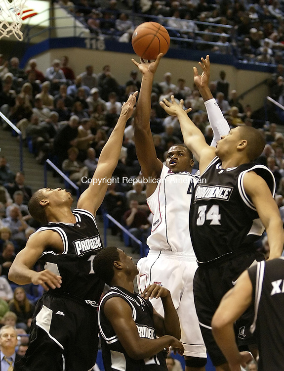 HARTFORD, CT, 01/17/08- 011708BZ09- UConn's Jeff Adrien (4) shoots over the defense of Providence's Geoff McDermott (11), Brian McKenzie(23) and Jonathan Kale (34) during their game at the XL Center in Hartford Thursday night.<br /> Jamison C. Bazinet Republican-American