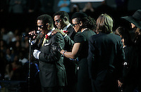 LOS ANGELES,CA - JULY 7,2009: Marlon Jackson, brother of Michael Jackson, is comforted by his family during final thank you to those gathered for memorial at Staples Center, July 7, 2009. A rose covered coffin holding the remains of Michael Jackson rests in the front of stage. Jackson, 50, died June 25th, after suffering an apparent cardiac arrest at his home in Los Angeles. Jackson is survived by his three children; son, Prince Michael Jr., daughter, Paris Michael Katherine, and son Prince Michael II.  Michael Jackson sold more than 750 million records, had 13 number one singles, more than any other male artist, and is one of the few artists to have been inducted into the Rock and Roll Hall of Fame twice; once as a member of The Jackson 5 in 1997 and later as a solo artist in 2001.