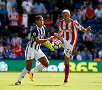 Jake Livemore of West Bromwich Albion tussles with Darren Fletcher of Stoke City during the premier league match at the Hawthorn's Stadium, West Bromwich. Picture date 27th August 2017. Picture credit should read: Simon Bellis/Sportimage
