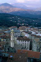 Quaint townscape and the surrounding mountains at sunset, Corte, Corsica, France.