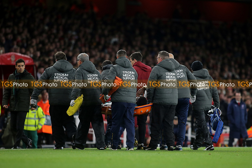 Danny Welbeck of Arsenal is carried off in the first half during Arsenal vs Sporting Lisbon, UEFA Europa League Football at the Emirates Stadium on 8th November 2018