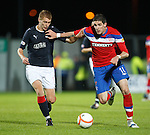 Kyle Lafferty holds off Jay Fulton