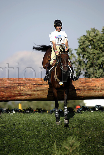 17 August 2004: Canadian rider Ian Roberts (CAN) riding Mata-Riki jump a fence at the lake on the Cross Country course during the Eventing Competition held at the Markopoulo Olympic Equestrian Centre. 2004 Olympic Games, Athens, Greece. Photo: Neil Tingle/Action Plus...040817 olympics olympic three-day event three day events 3-day 3 day eventing eventer eventers equestrian sport sports.