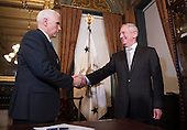 United States Marine Corps General James Mattis shakes hands with Vice President Mike Pence after being sworn-in as Defense Secretary, in the Vice Presidential ceremonial office in the Executive Office Building in Washington, D.C. on January 20, 2017.    <br /> Credit: Kevin Dietsch / Pool via CNP