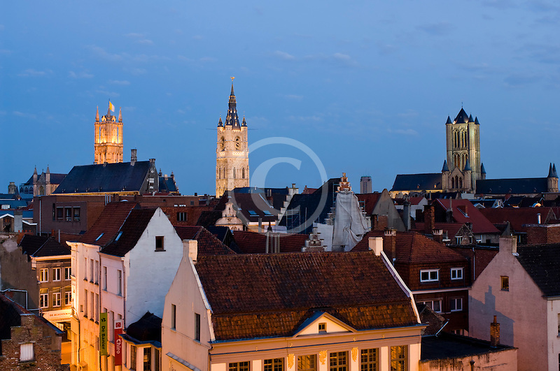Belgium, Ghent, St. Bavo's Cathedral and Belfry and red-tiled roofs at dusk