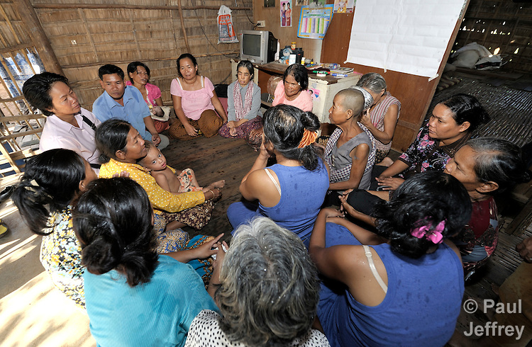 A women's self-help group meets in the home of one of its members in the Phnom Penh neighborhood of Sen Rikreay. Many people in this community are infected or affected by HIV and AIDS.