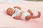 Newborn baby girl 12 days old on back full length peeling skin typical of newborn