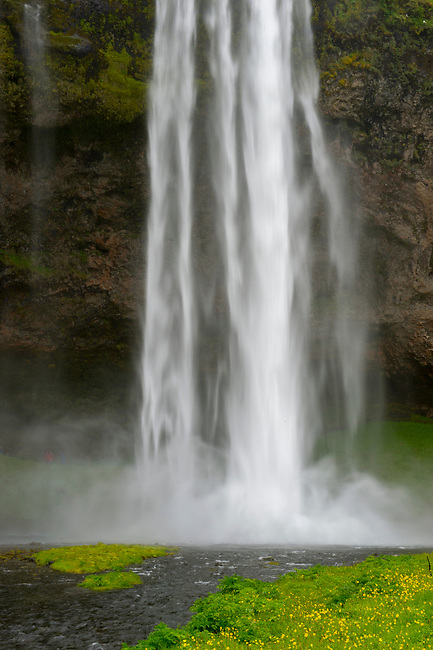 The Seljalandsfoss is located in the South Region in Iceland and the waterfall drops 60 m (197 ft) and is part of the Seljalands River that has its origin in the volcano glacier Eyjafjallajökull.