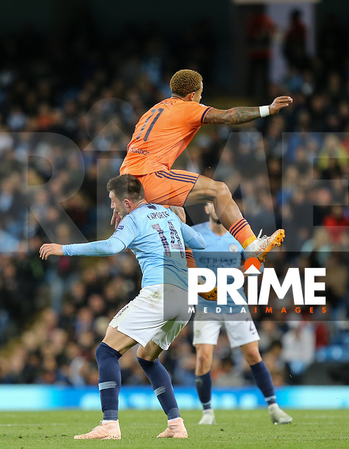 Memphis DEPAY of Olympique Lyonnais on Aymeric LAPORTE of Manchester City during the UEFA Champions League match between Manchester City and Olympique Lyonnais at the Etihad Stadium, Manchester, England on 19 September 2018. Photo by David Horn / PRiME Media Images.