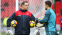 Swansea City goalkeeper coach Tony Roberts talks with Lukasz Fabianski of Swansea City prior to kick off of the Premier League match between Stoke City and Swansea City at the bet365 Stadium, Stoke on Trent, England, UK. Saturday 02 December 2017
