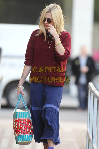 Fearne Cotton arriving at BBC Radio 1,.London, England..July 12th, 2012.half length red maroon burgundy knitted top jumper sweater sunglasses shades blue skirt turquoise blue bag purse hand arm bracelets.CAP/HIL.©John Hillcoat/Capital Pictures.