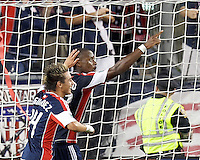 New England Revolution forward Dimitry Imbongo (92) celebrates his goal with New England Revolution forward Diego Fagundez (14). In a Major League Soccer (MLS) match, the New England Revolution defeated Columbus Crew, 2-0, at Gillette Stadium on September 5, 2012.