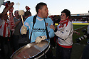 Ashley Bayes of Stevenage Borough bangs the drum to celebrate winning promotion after the Blue Square Premier match between Kidderminster Harriers and Stevenage Borough at the Aggborough Stadium, Kidderminster on Saturday 17th April, 2010..© Kevin Coleman 2010