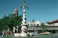 Kansas City:  Country Club Plaza--an upscale  shopping center and residential neighborhood developed by J. C. Nichols, 1922. Designed by E. B. Delk using Seville, Spain as a model.  Parking is concealed.  Art works are scattered throughout the center.