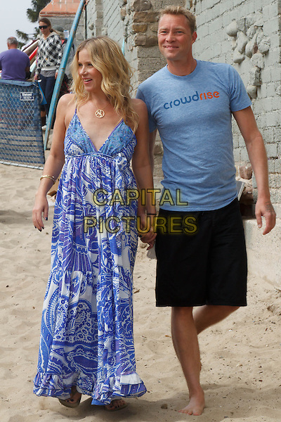 CHRISTINA APPLEGATE, MARTYN LENOBLE.5th Annual Surfrider Foundation Expressions Session at Surfrider Beach. Malibu, CA, USA, September 11th, 2010. .full length long maxi print dress maternity couple pregnant blue t-shirt white black shorts holding hands .CAP/CEL.©CelPh/Capital Pictures.