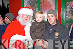 Excited to see Santa turning on Abbeyfeale's Christmas Lights on Friday night were Rhys and his father Declan Kelliher.
