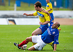 Cowdenbeath v St Johnstone....21.07.12  pre-season friendly.Colin Cameron tackles Kevin Moon.Picture by Graeme Hart..Copyright Perthshire Picture Agency.Tel: 01738 623350  Mobile: 07990 594431