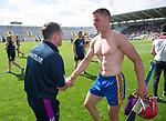 David Fitzgerald, Wexford Manager congratulates John Conlon of Clare following the All-Ireland quarter final at Pairc Ui Chaoimh. Photograph by John Kelly.