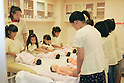 "KIDZANIA TOKYO, ""Edutainment City"",.children taking care of baby dolls on the nursing facilities.."
