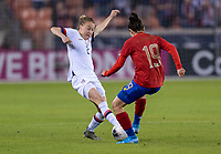 HOUSTON, TX - FEBRUARY 03: Emily Sonnett #3 of the United States collides with Jazmin Elizondo #19 of Costa Rica during a game between Costa Rica and USWNT at BBVA Stadium on February 03, 2020 in Houston, Texas.