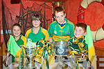 Welcoming the Bishop Moynihan Cup, players & management of the South Kerry team to the Bridge Bar & Restaurant in Portmagee on Saturday night last were Ciara O'Sullivan, Tara O'Sullivan, Anthony O'Driscoll & Daniel O'Sullivan.
