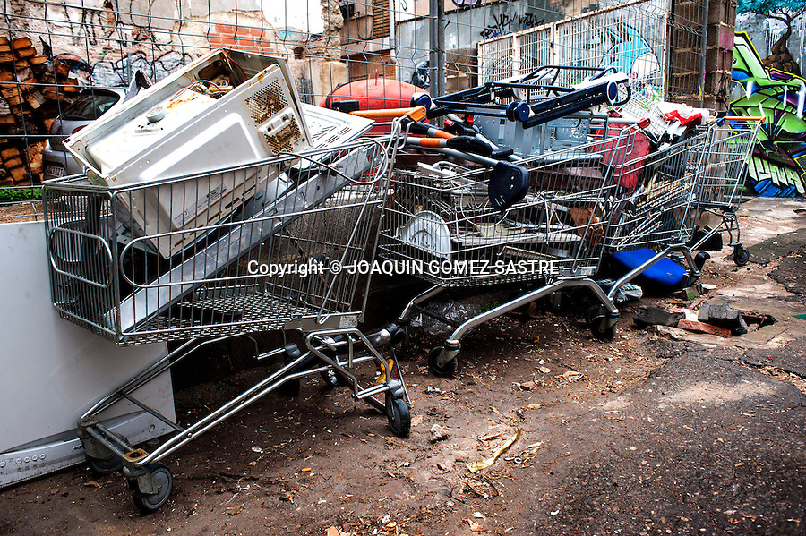 Grocery carts full of junk collected on the streets of Valencia.