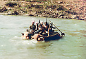 Iraq 1963 .The crossing of a river on a raft.Irak 1963.La traversee d'une riviere par des peshmergas sur un radeau