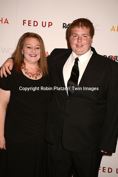 "Tinna and Brady Kluge attend the New York Premiere of ""FED UP"" on May 6, 2014 at The Museum of Modern Art in New York City."