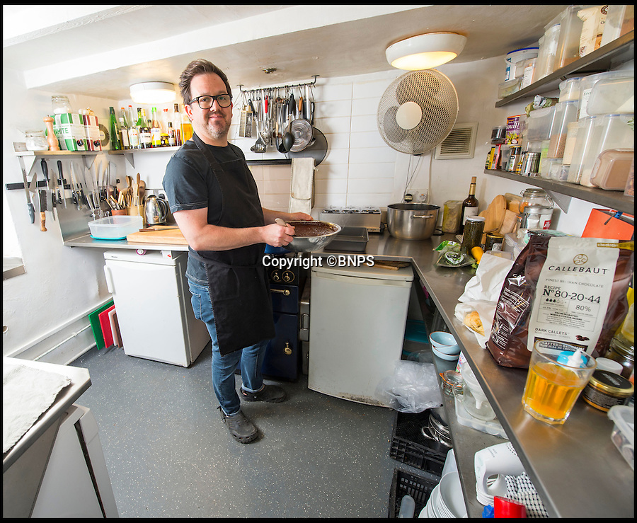 BNPS.co.uk (01202 558833)<br /> Pic: PhilYeomans/BNPS<br /> <br /> Unconventional chef Matt Watson is cooking up a storm with his new restaurant - which he's opened in his front room.<br /> <br /> Despite only having one standard oven to cook with and no formal training, Matt Watson, 43, shifted his sofas to one side and launched his unlikely venture, and now business is booming.<br /> <br /> The self-taught cook, who got an E in home economics at school, packed in his decorating and DIY job to launch Matt's Kitchen in his house, which was once a shop, in Bruton, Somerset.<br /> <br /> The cosy restaurant can only seat 26 people at a time but Matt allows customers to bring their own booze.