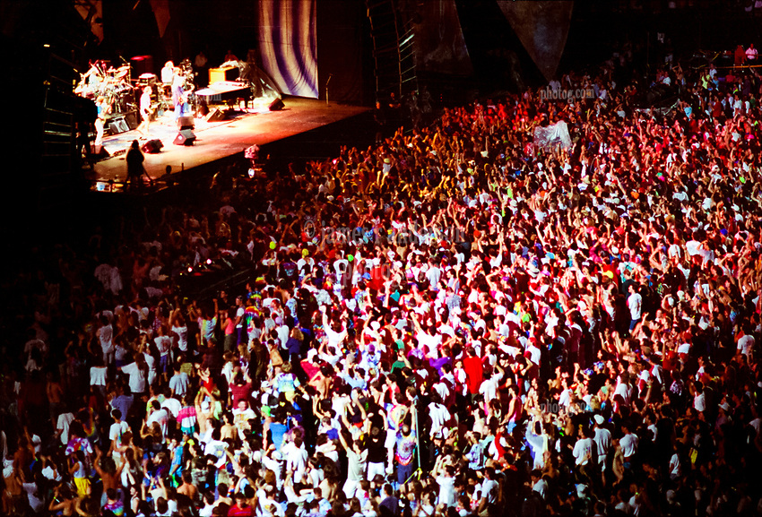 The Grateful Dead Live in Concert at Giants Stadium June 17, 1991. High Energy Audience, Band, Stage and Lights Capture Image.