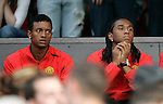 Manchester United's new signings Nani and Anderson watch the game from the stand