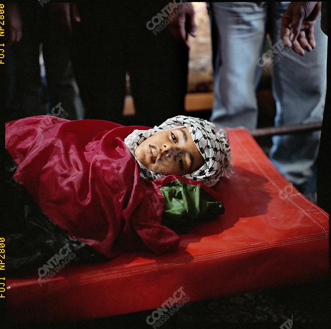 Victim of Plestinian and Israeli violence, Gaza City, July 2004